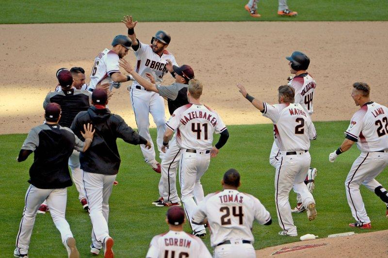 Arizona Diamondbacks' Daniel Descalso (with arm raised) and the team celebrate. File photo by Art Foxall/UPI