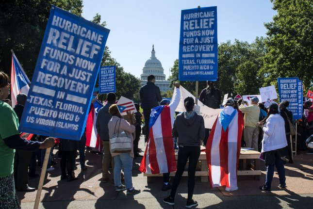 Protesters call on Congress and the Trump administration for a recovery package for victims of Hurricane Maria in Puerto Rico on Capitol Hill in Washington, D.C., on October 18, 2017. File Photo by Kevin Dietsch/UPI