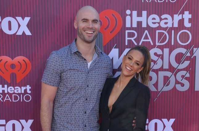 Mike Caussin (L), pictured with Jana Kramer, discussed his sex addiction ahead of the one-year anniversary of his sobriety. File Photo by Jim Ruymen/UPI