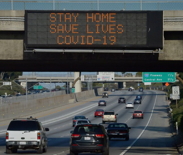 A health alert is posted along Interstate 105 in Los Angeles, Calif., on March 29, 2020. Thursday's report says that almost 3,000 additional people died in vehicle crashes last year despite a decline in U.S. traffic due to the coronavirus pandemic. File Photo by Jim Ruymen/UPI