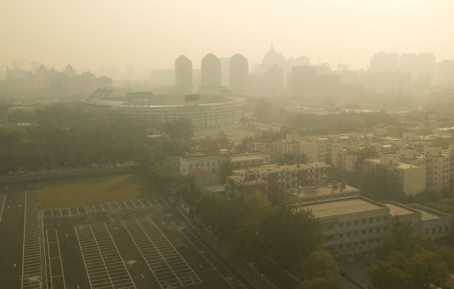 A dense haze hangs over a former Olympic venue as well as central Beijing November 4, 2008. (UPI Photo/Stephen Shaver)