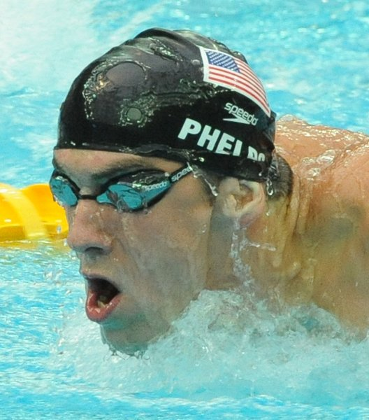 USA's Michael Phelps ties his own Olympic record of 1:53.70 during the Men's 200 Meter Butterfly semifinals at the National Aquatic Center (Water Cube) during the 2008 Summer Olympics in Beijing, China, on August 12, 2008. (UPI Photo/Roger L. Wollenberg)