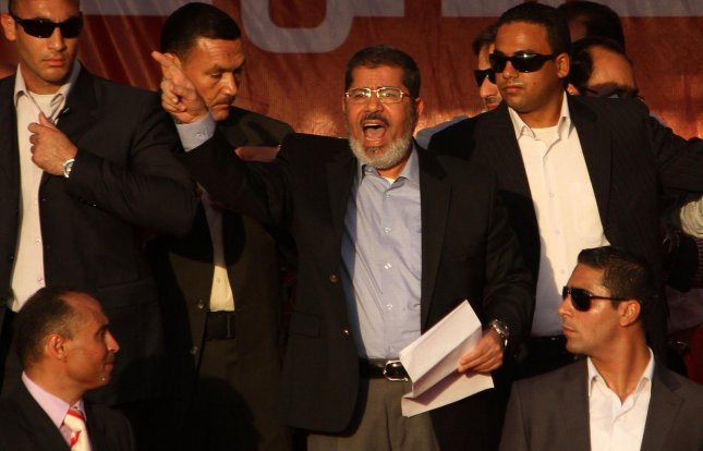 Egyptian President Mohamed Morsi (c) voiced support for Syrian rebels at the Non-Aligned Movement summit in Tehran, sparking a walkout by Syrian delegates. June 29 file photo. UPI/Ahmed Jomaa