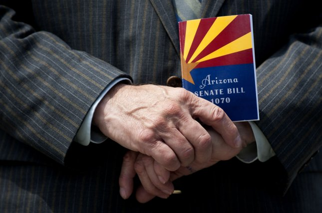 Rep. Steve King (R-IA) holds a copy of Arizona Senate Bill 1070, the Support Our Law Enforcement and Safe Neighborhoods Act. UPI/Kevin Dietsch