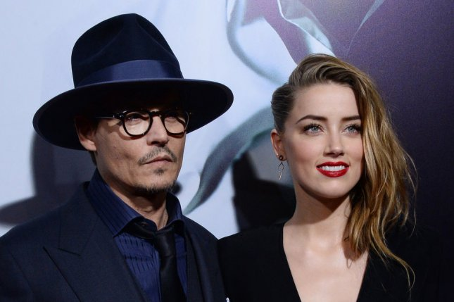 Amber Heard (R) and Johnny Depp married for a second time in the Bahamas. Photo by Jim Ruymen/UPI