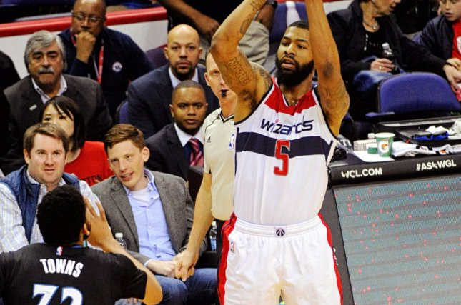 Washington Wizards forward Markieff Morris (5) scores on a three point basket against Minnesota Timberwolves center Karl-Anthony Towns (32) in the first half at the Verizon Center in Washington, D.C. on March 25, 2016. Photo by Mark Goldman/UPI