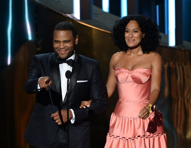 Anthony Anderson (L) and Tracee Ellis Ross onstage during the 67th Primetime Emmy Awards in Los Angeles on September 20, 2015. The pair will return as hosts for this year's BET Awards ceremony. File Photo by Ken Matsui/UPI.