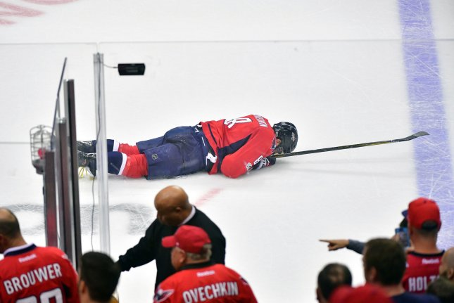 Washington Capitals left wing Alex Ovechkin (8) lays on the ice after being hit by Toronto Maple Leafs center Nazem Kadri in the first period of game 3 of the Eastern Conference Quarterfinals at the Verizon Center in Washington, D.C. on April 21, 2017. Photo by Kevin Dietsch/UPI