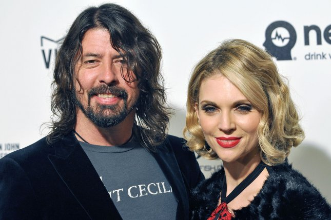 Foo Fighters frontman Dave Grohl (L) and his wife Jordyn Blum arrive at the Elton John Aids Foundation's 24th Annual Academy Awards viewing party on February 28, 2016. Grohl called his daughter onstage at a Foo Fighters concert in Iceland to show off her new drum skills. File Photo by Christine Chew/UPI