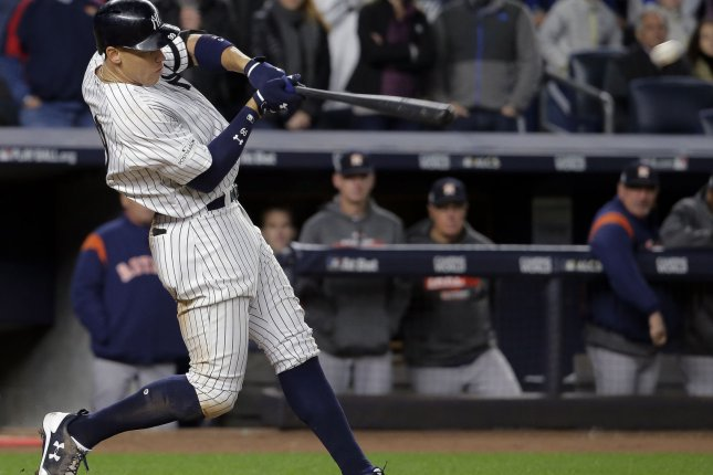 New York Yankees right fielder Aaron Judge hits a three-run home run against the Houston Astros in the fourth inning in Game 3 of the 2017 MLB Playoffs American League Championship Series Monday at Yankee Stadium in New York City. Photo by Ray Stubblebine/UPI
