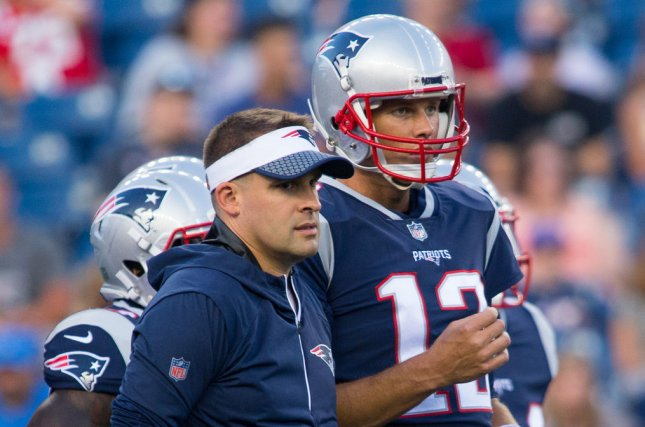 New England Patriots quarterback Tom Brady (R) gives a hug to offensive coordinator Josh McDaniels during warm ups before a preseason game against the Jacksonville Jaguars at Gillette Stadium in Foxborough, Massachusetts on August 10, 2017. File photo by Matthew Healey/UPI
