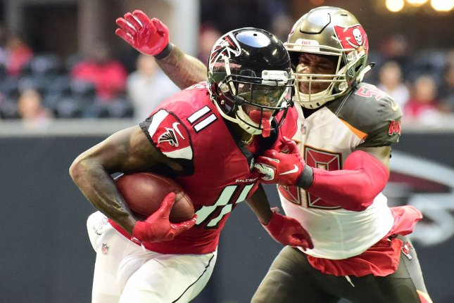 Atlanta Falcons wide receiver Julio Jones (11) makes a first down reception in front of Tampa Bay Buccaneers outside linebacker Kwon Alexander (58) during the first half of an NFL game on October 14 at Mercedes-Benz Stadium in Atlanta. Photo by David Tulis/UPI