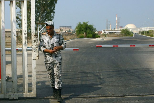 A guard walks in front of the nuclear power plant in Bushehr in southern Iran. File Photo by Maryam Rahmanian/UPI