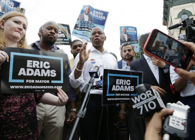 Brooklyn Borough President and New York City mayoral candidate Eric Adams speaks to the media after casting his vote in New York City on Tuesday. Photo by John Angelillo/UPI