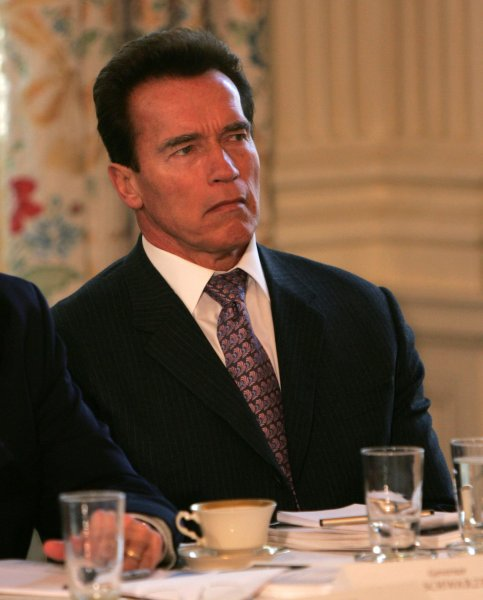California Gov. Arnold Schwarzenegger listens as President George W. Bush addresses the National Governors Association during a meeting at the White House in Washington on February 25, 2008. (UPI Photo/Dennis Brack/Pool)