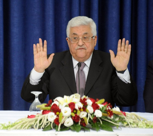 Palestinian President Mahmoud Abbas gestures as he delivers a speech beside chief peace negotiator Saeb Erakat during a meeting with Israel peace activists and press in the presidential headquarters in Ramallah, West Bank, April 28, 2011. President Abbas said he will have final authority in the make-up of the future Hamas-Fatah cabinet and hoped a unity government will promote peace talks with Israel. UPI/Debbie Hill