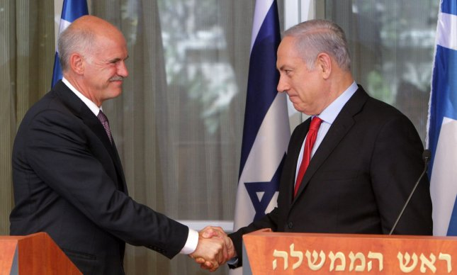 Greek Prime Minister George Papandreou (R) and Israeli Prime Minister Benjamin Netanyah shakes hands after they spoke in his Jerusalem residence on July 22, 2010. Papandreou spoke of the need to open the Gaza Strip more, despite Israel's lifting of the goods embargo entering Gaza. UPI/Jim Hollander/Pool