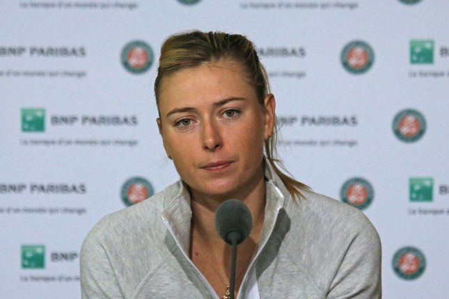Maria Sharapova speaks to the press after losing her French Open women's fourth round match on June 1, 2015. Sharapova is hoping for a reduced punishment for her recent doping offense. File photo by David Silpa/UPI