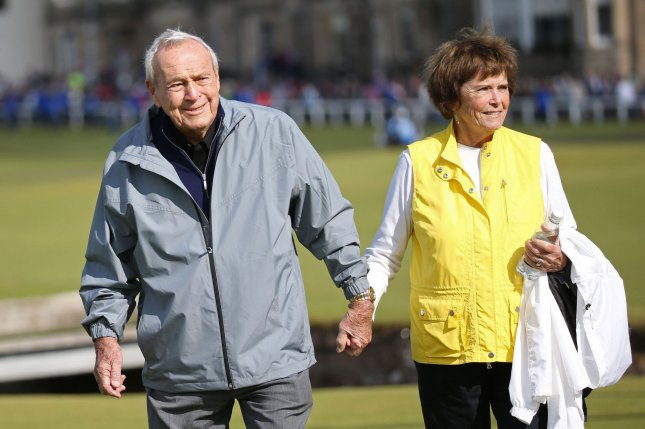 Arnold Palmer (L) seen with his wife Kathleen Gawthrop in this July 15, 2015 file photo from the the144th Open Championship at St.Andrews, died today, September 25, 2016, at 87 according to a USGA statement. The seven-time major winner was known as the king of golf and given credit for bringing the sport to the masses. File Photo by Hugo Philpott/UPI