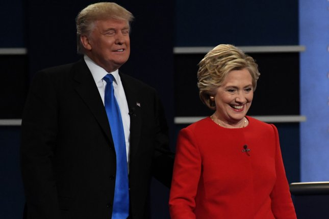 Democrat Hillary Clinton and Republican Donald Trump on stage at the first presidential debate at Hofstra University in Hempstead, N.Y., on September 26, 2016. A police department in Kansas shared a series of tongue-in-cheek tweets warning residents not to call 911 to express their anger toward the candidates. Photo by Pat Benic/UPI