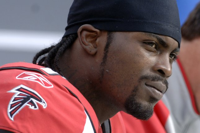 Former Atlanta Falcons star Michael Vick clarified statements he made, saying he has not had talks with the team about signing a one-day contract so he can retire with the team. File photo UPI Photo/Kevin Dietsch.