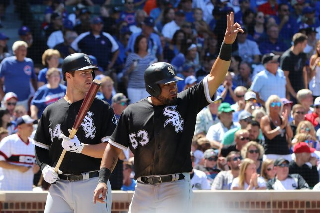 Chicago White Sox's Melky Cabrera (53) signals Jose Abreu after scoring on his RBI double during the fifth inning of a game against the Chicago Cubs at Wrigley Field in Chicago Illinois on July 24, 2017. File photo by Aaron Josefczyk/UPI