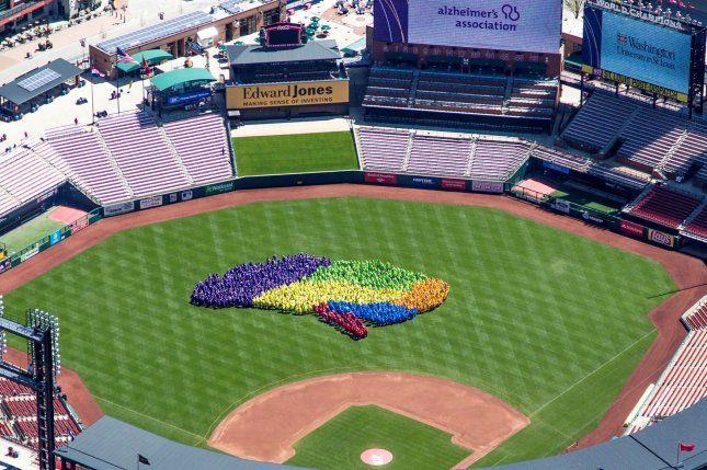 Financial services firm Edward Jones and the Alzheimer's Association joined forces to set a new Guinness world record title for the largest human image of a brain on the field of Busch Stadium in St. Louis on Saturday. Photo by Edward Jones/UPI
