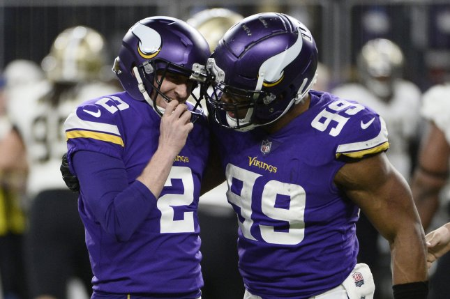 Minnesota Vikings defensive end Danielle Hunter (R) congratulates kicker Kai Forbath after Forbath made a 53-yard field goal during the fourth quarter of the NFC Divisional Round playoff game against the New Orleans Saints on January 14, 2018 at U.S. Bank Stadium in Minneapolis. Photo by Brian Kersey/UPI