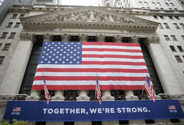 The Dow Jones Industrial Average climbed nearly 300 points on Thursday, as bank stocks rose after the Federal Reserve announced changes to the Volcker Rule, rebounding slightly after dropping 700 points on Wednesday. File Photo by John Angelillo/UPI