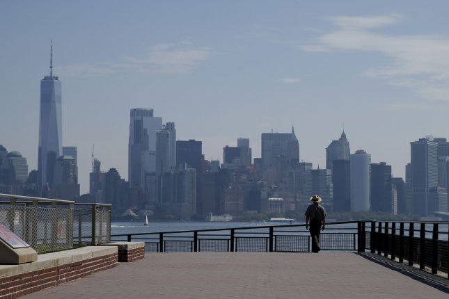 A park ranger wears a face mask while walking the grounds around the Statue of Liberty on Liberty Island on Monday. Photo by John Angelillo/UPI