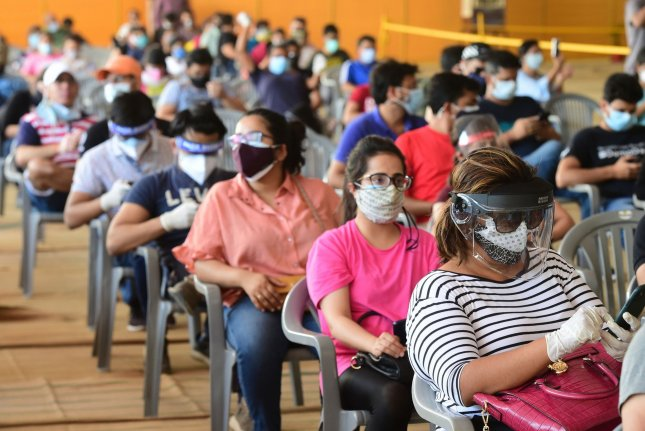 People wait to receive COVID-19 vaccine doses at one of the largest vaccination sites at Radhaswami Satsang in New Delhi, India, on May 4. Photo by Abhishek/UPI