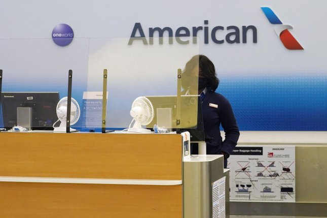 An American Airlines ticket agent is seen at St. Louis-Lambert International Airport in St. Louis, Mo., on February 8.The carrier said some flights over the weekend were canceled because flight crews weren't available. File Photo by Bill Greenblatt/UPI