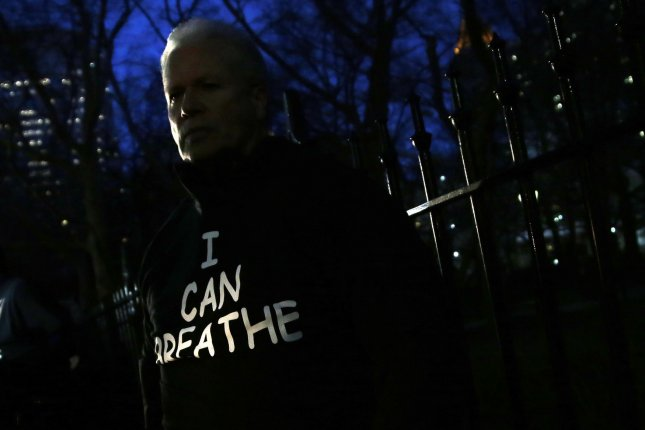 A demonstrator wears an I Can Breathe shirt near City Hall in lower Manhattan over 2 weeks after a decision by a grand jury not to indict an NYPD officer involved in the apparent chokehold death of Eric Garner in New York City on December 19, 2014. Demonstrators gathered at City Hall in support of the NYPD Friday evening, but they were met right away with a rival demonstration by critics of police policies. Garner, a 43 year old father of six, died in July after police officers attempted to arrest him for allegedly selling loose, untaxed cigarettes in the Tompkinsville section of Staten Island. UPI/John Angelillo