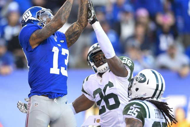 New York Giants wide receiver Odell Beckham (13) drops a pass as New York Jets cornerback Darrin Walls (26) and New York Jets strong safety Calvin Pryor (25) defend in the 2nd quarter at MetLife Stadium in East Rutherford, New Jersey on December 6, 2015. Photo by Rich Kane/UPI