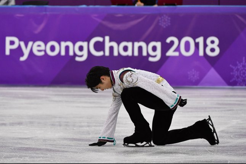 Yuzuru Hanyu of Japan celebrates his gold medal-winning performance in the men's single skating short program during the Pyeongchang Winter Olympics on February 17. Photo by Richard Ellis/UPI