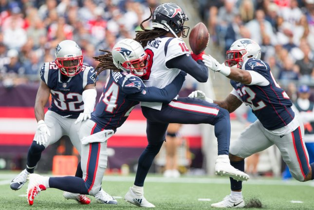 New England Patriots cornerback Stephon Gilmore (24) and linebacker Elandon Roberts (52) break up a pass intended for Houston Texans wide receiver DeAndre Hopkins (10) in the second quarter on September 9, 2018 at Gillette Stadium in Foxborough, Massachusetts. Photo by Matthew Healey/UPI
