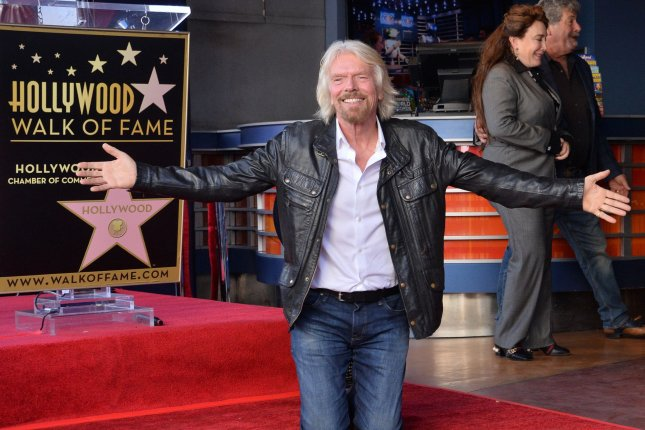 Richard Branson kneels next to his star on the Hollywood Walk of Fame in Los Angeles on October 16, 2018. File Photo by Jim Ruymen/UPI