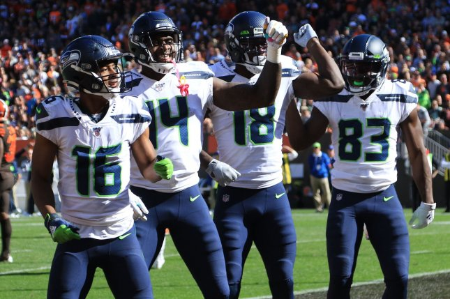 Seattle Seahawks wide receivers Tyler Locket (16), DK Metcalf (14), David Moore (83) celebrated a second quarter touchdown by Jaron Brown (18) with an NSYNC dance Sunday in Cleveland. Photo by Aaron Josefczyk/UPI