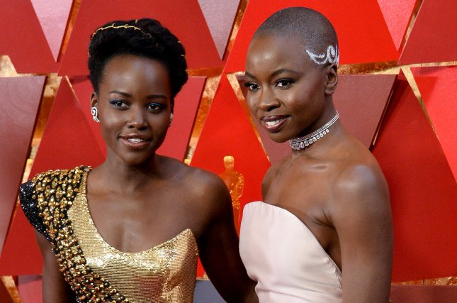 Lupita Nyong'o (L) and Danai Gurira arrive on the red carpet for the 90th annual Academy Awards on March 2018. The pair's planned Americanah adaptation will no longer be going into production. File Photo by Jim Ruymen/UPI