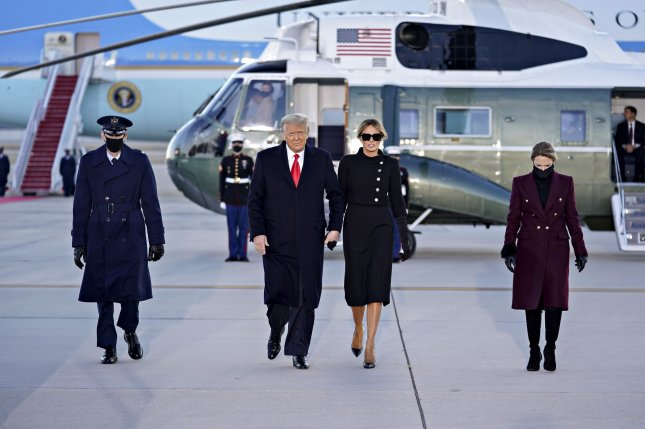 President Donald Trump (L), and first lady Melania Trump arrive to a farewell ceremony at Joint Base Andrews, Md., on Wednesday. Photo by Stefani Reynolds/UPI