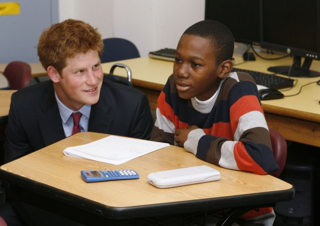 Prince Harry (L) of Britain speaks to student in a classroom during a tour.Two to three pupils in every classroom has specific learning disabilities such as dyslexia, ADHD and autism. (UPI Photo/Lucas Jackson/Pool)