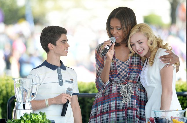 Comedian Peyton List (R) and Cameron Boyce(L) from the comedy series Jessie makes a healthy drink with First Lady Michelle Obama during the annual White House Easter Egg Roll on the South Lawn of the White House April 21, 2014 in Washington, DC. President Barack Obama and first lady Michelle Obama hosted thousands of people during the annual celebration of Easter. UPI/Olivier Douliery/Pool