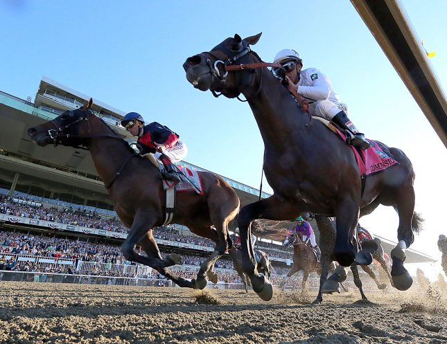 Tonality, Joel Rosario up, left, wins the 146th Belmont Stakes Belmont Park in Elmont, New York, June 7, 2014. Commissioner, ridden by Javier Castellano finished second. (right) UPI/Mark Abraham