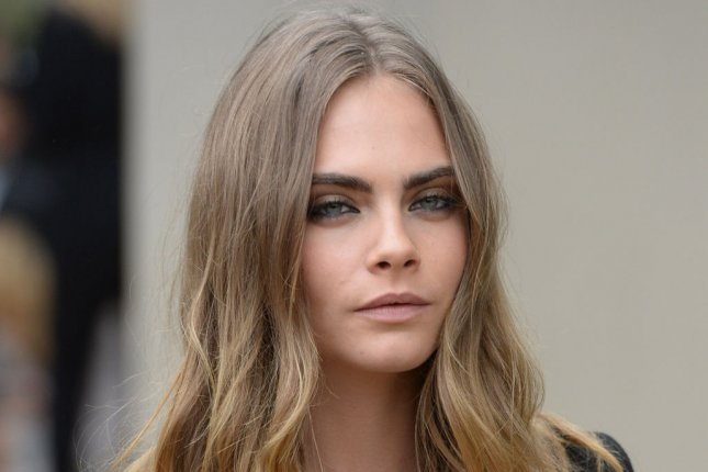 Cara Delevingne arrives at the Burberry Prorsum show at London Fashion Week on September 21, 2015. The actress recently covered Empire magazine as Enchantress. File photo by Rune Hellestad/UPI