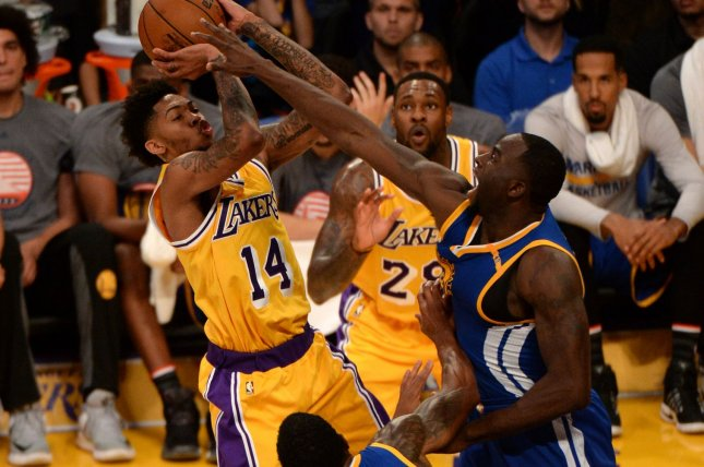 Los Angeles Lakers forward Brandon Ingram (14) shoots over Golden State  Warriors forward Draymond Green during the second half of their NBA game at  Staples ... 4840cfeab