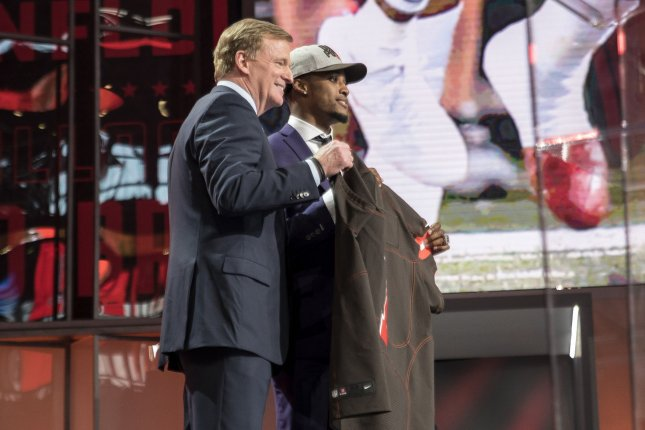 Denzel Ward poses with NFL commissioner Roger Goodell after being selected by the Cleveland Browns with the fourth overall pick in the 2018 NFL Draft on April 26. Photo by Sergio Flores/UPI