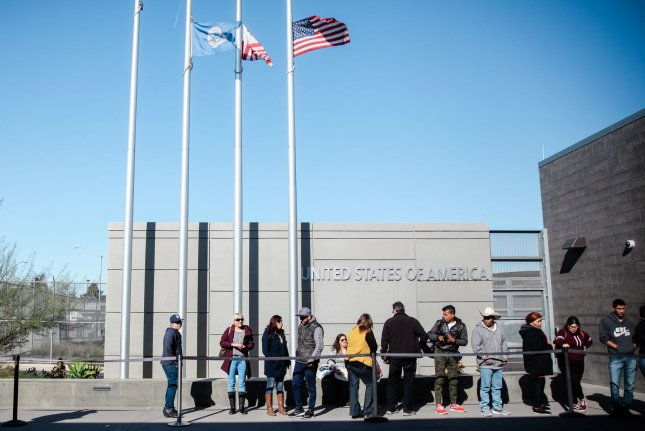 People stand in line at the Port of Entry in San Ysidro, Calif., on December 29, 2018. File Photo by Ariana Drehsler/UPI