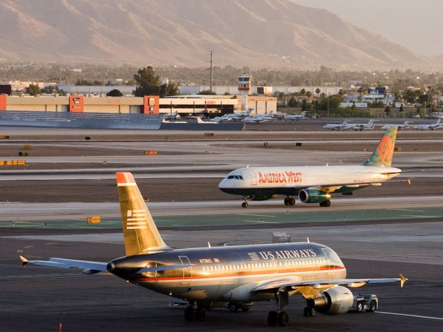 Three landings were briefly delayed at Phoenix Sky Harbor International Airport in Arizona when a coyote was spotted wandering loose near the runway. File Photo by Will Powers/UPI