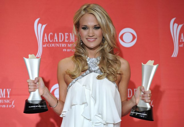 Carrie Underwood, Entertainer of the Year and Top Female Vocalist winner, poses with her awards at the 44th Annual Academy of Country Music Awards at the MGM Grand in Las Vegas, Nevada on April 5, 2009. (UPI Photo/Kevin Dietsch)
