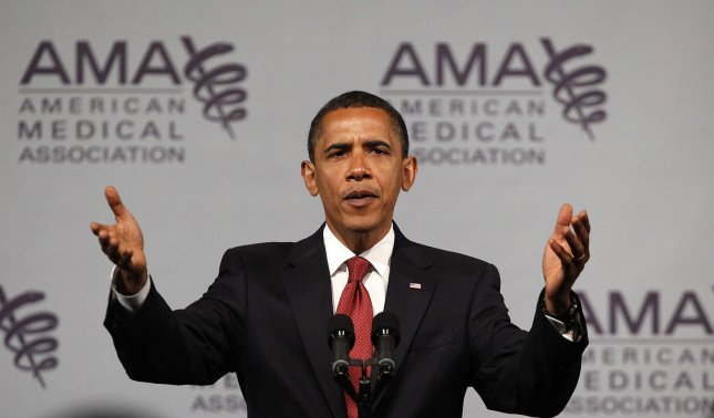 President Barack Obama addresses the American Medical Association's annual meeting on June 15, 2009 in Chicago. Obama's speech to the AMA is his latest effort to persuade skeptics that his health care plan is worth the expected high cost. (UPI Photo/Brian Kersey)